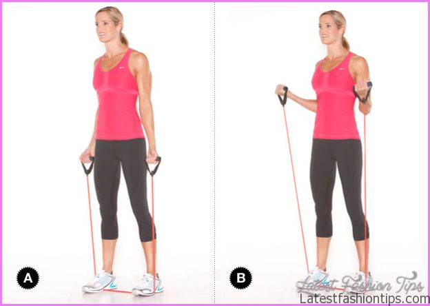 Stand with feet shoulder width apart, knees slightly bent, and at a ...