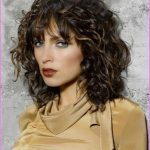 layered-haircuts-for-curly-hair-and-round-face.jpg