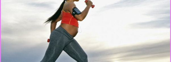 pregnant-woman-walking-with-weights-outdoors_700x700_Getty-508482589.jpg
