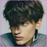 long-fringe-haircut-for-men-dark-hair.jpg