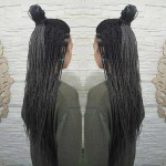 4. A Half Top Knot With Braids